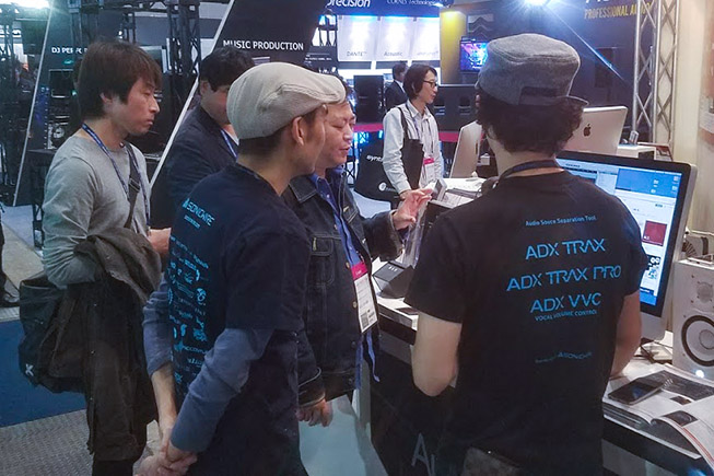 Taka (right) with Shigeru explaning Audionamix technology to a lucky guest